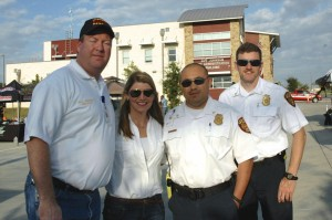 Leander's Fire Chief and staff visit Dr. Hagen at the Fall Festival.