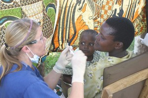 Dr. Hagen checks a Tanzanian mom and child.