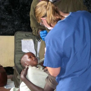 Dr. Hagen treating a Maasai mom and child.